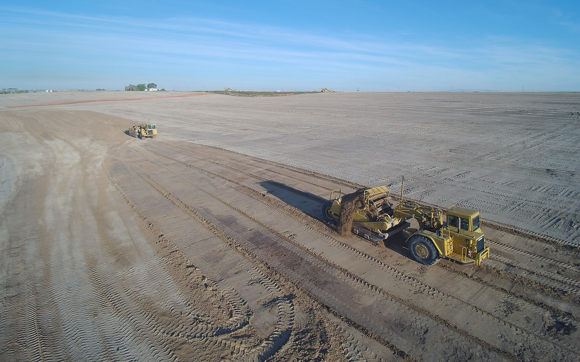 Aerial view of bulldozer leveling dirt lot