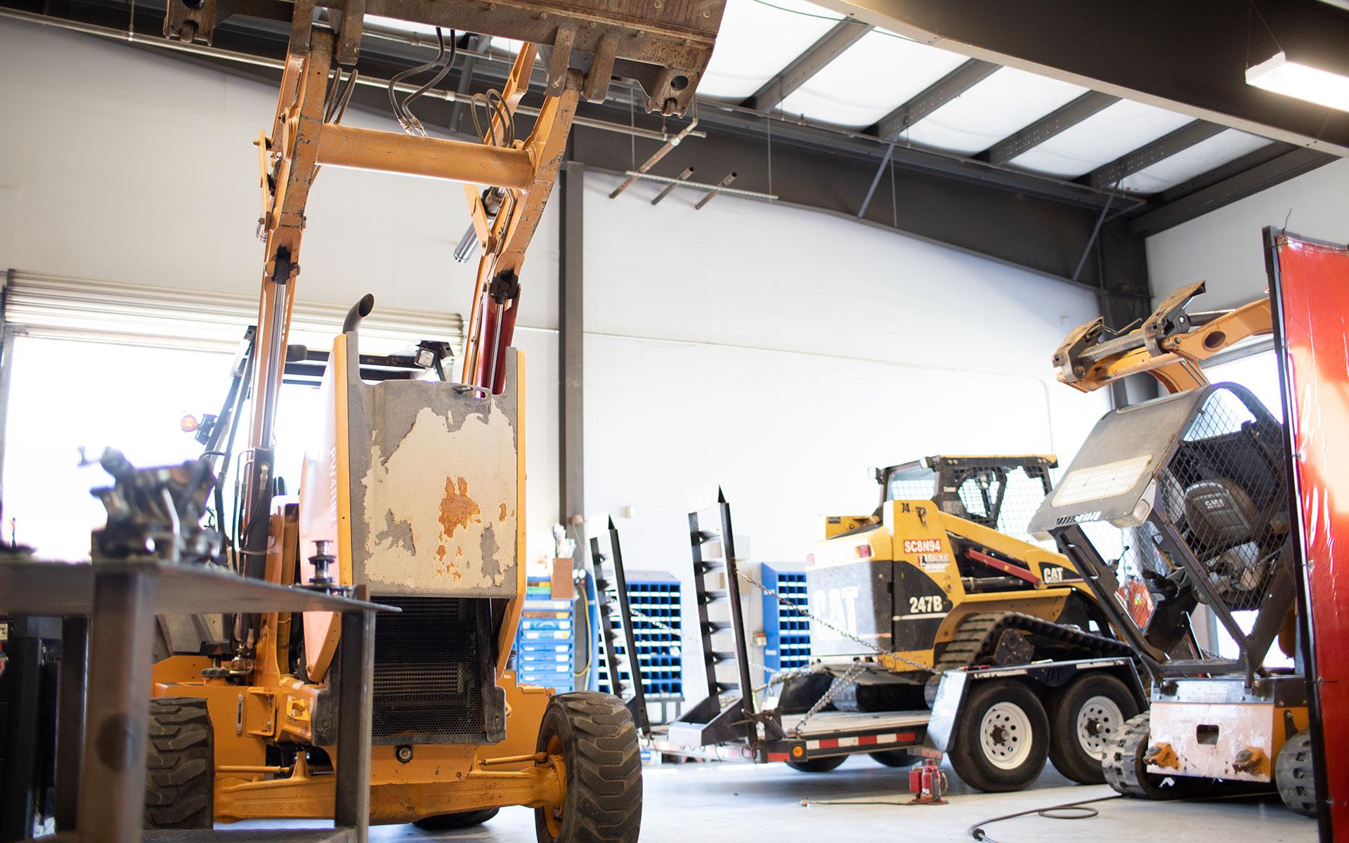 Bulldozers inside of LOKES Rental Equipment warehouse