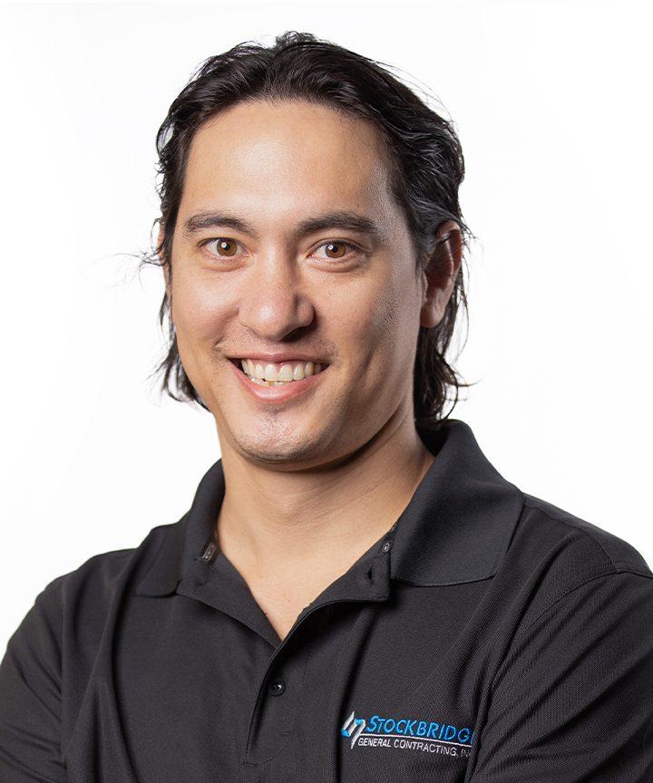 Employee headshot of Adam Wong